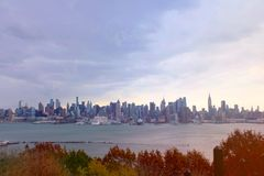 New York City skyline view. Fall season. New York City skyline view in the fall season. Vintage filter. Cloudy dramatic sky royalty free stock photo