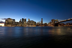 The New York City skyline at w Brooklyn Bridge Stock Images