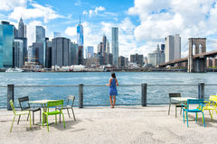 New York city skyline waterfront lifestyle woman. New York city skyline waterfront lifestyle - woman enjoying view. American people walking enjoying view of royalty free stock photos