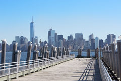 New York city skyscrapers and empty pier Royalty Free Stock Photo