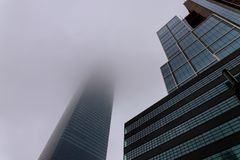 New York City skyscrapers in foggy sky. Downtown skyscrapers in Manhattan New York City skyscrapers in foggy sky stock image