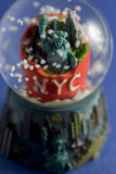 New York city snow globe. Closeup of New York city snow globe with Statue of Liberty Royalty Free Stock Images