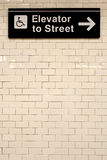 New York City Station subway directional sign on tile wall. Royalty Free Stock Photography