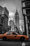 New York City street in the Evening. In black and white and only a yellow cab in color Stock Image