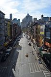 New York City Street. A long street in New York City Chinatown almost empty as the sun rises Stock Photos