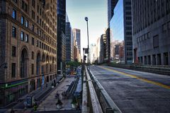 New York City Street Scene. High rise. buildings, early morning, right turn lane Royalty Free Stock Images