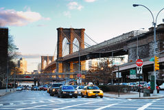 New York City Street View. With Brooklyn Bridge and traffic Stock Photos