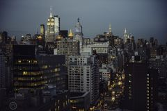 New York City streets view to Manhattan Midtown at twilight time. New York City streets view to Manhattan Midtown at twilight time Royalty Free Stock Photography