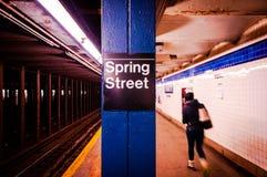 New York City Subway Station, Spring Street Station, Subway Stat. New York City Subway Station sign on the platform with passenger walking Stock Photo