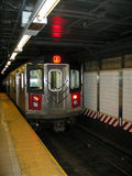 New York City Subway Train Entering Station Stock Photos