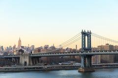 New York city sunset with focus on Manhattan Bridge Royalty Free Stock Photography