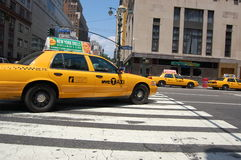 New York City Taxi. A few yellow NYC taxis, a popular form of transportation in the city Royalty Free Stock Image