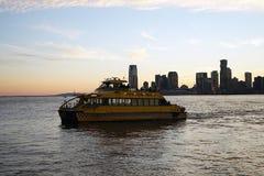 New York City Taxi Boat Skyline yellowo USA yellow royalty free stock photo