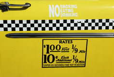 New York City taxi rates decal. This rate was in effect from April 1980 till July 1984. Old New York City taxi rates decal. This rate was in effect from April stock photo
