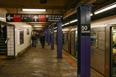 New York City 50th Street Subway Station. The MTA 50th Street Subway car station platform and passengers in mid-town Mahattan near the Broadway Theater District Stock Photography