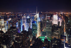 New York City Times Square. New York City Manhattan Times Square panorama aerial view at night with office building skyscrapers skyline illuminated by Hudson stock images