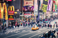 New York City - Times Square, real tilt-shift lens. New York City - Times Square with Yellow Cab and many people, real tilt-shift lens, 19 of December 2015 Royalty Free Stock Photo