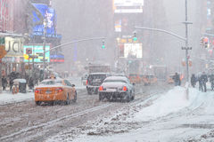 New York City Times Square in snow winter slushy. New York City Times Square in snow cold cars sorbets Stock Image