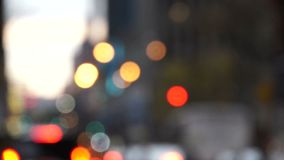 New York City traffic, bokeh effect. A look at colorful, round New York City traffic lights during a busy day in bokeh effect stock footage