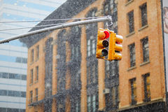 New York city traffic lights with skyscrapers on background during snowfall Royalty Free Stock Images