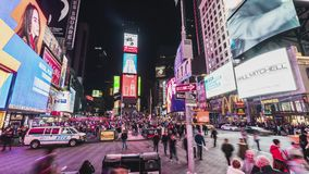 New York City, United States - Mar 31, 2019: Crowded people, car traffic transportation and billboards at Times Square