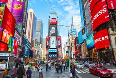 New York City, United States - November 2, 2017: Crowds gather in Times Square at day time. Tourist intersection of neon art and commerce and is an iconic Stock Images