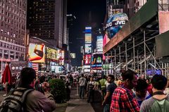 New York City - United States - 25.05.2014 - Times Square night people walking around Cars Taxi driving Stock Photography