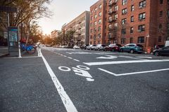 New York City Uptown street with residential building and bicycle road Stock Image