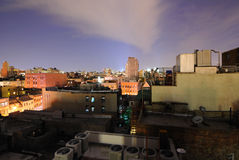 New York City Urban Rooftops. New York City rooftops in the evening Stock Photos