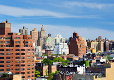 New York City Urban Scene. Urban scene of high rises in Lower Manhattan viewed from a Chelsea rooftop Royalty Free Stock Photo