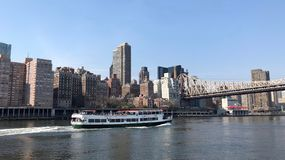 New York City, USA - April 2018: Cruising on boat along the East River and Manhattan royalty free stock photo