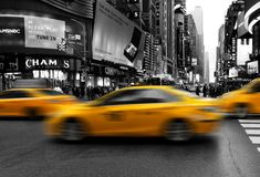 Taxis in midtown Manhattan rushing. New York City, USA - April 2018: taxis in midtown Manhattan selective color Royalty Free Stock Photography