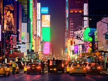 Yellow taxis and traffic at times square midtown at night Royalty Free Stock Photos