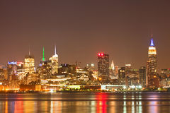New York City, USA colorful night skyline panorama. With illuminated landmark buildings in downtown business and residential districts stock images