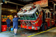 NEW YORK CITY, USA - 04, 2017 : FDNY fire truck backs into garage. Ladder 30 shares a house with Engine 59 in Harlem New York. Royalty Free Stock Photo