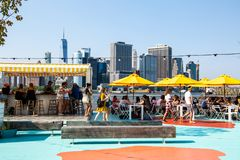 New York City / USA - JUL 14 2018: Oyster bar of Governors Island on a clear friday afternoon royalty free stock photos