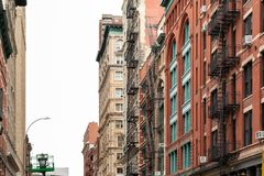 New York City / USA - JUN 27 2018: TriBeCa streets, and building. S facade, store, restaurant and cafe and apartments in Manhattan stock photography