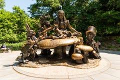Alice in Wonderland Sculpture in Central Park. New York City, USA - June 26, 2018: Alice in Wonderland Sculpture in Central Park. Alice in Wonderland stands stock image