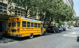 Yellow school bus parked on the street of New York City Royalty Free Stock Image