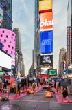 People in the yoga annual concentration in Times Square, New York City, USA stock images