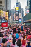 People in the yoga annual concentration in Times Square, New York City, USA. NEW YORK CITY, USA - JUNE 21, 2016: People in the yoga annual concentration on the royalty free stock photos