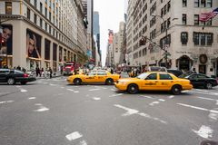 Yellow taxis and traffic in a crossroad Royalty Free Stock Images