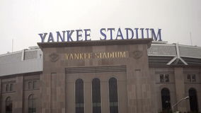New York City, USA - October 9, 2015: Driving past Yankee Stadium, Bronx, NY in the rain stock video footage