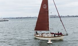 Sailboat in restricted area of Statue of Liberty stock photos