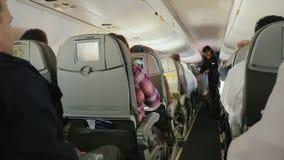 New York City, USA - OKTOBER, 2016: Flight Buffalo-NY. Service aircraft. Stewardess collects garbage from passengers stock footage