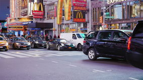 New York City, USA - OKTOBER, 2016: The intense traffic of cars and pedestrians in Times Square. The famous yellow cabs stock footage