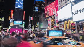 New York City, USA - OKTOBER 26, 2016: Times Square at night. Crowds of tourists and heavy traffic of cars and. Kingdom of neon signs. The famous Times Square stock footage