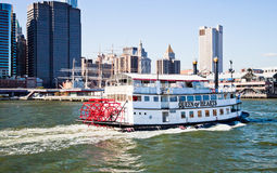 NEW YORK CITY, USA - Paddle Wheel Queen of Hearts steamboat. NEW YORK CITY, USA - SEPTEMBER 21 : Paddle Wheel Queen of Hearts steamboat is floating with tourists Stock Image