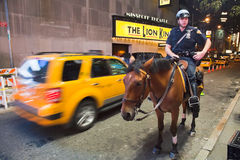 NEW YORK CITY, USA - Police officer rides her horse Stock Photos