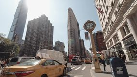 Tilt up view of busy traffic in the afternoon at Flatiron District Midtown Manhattan